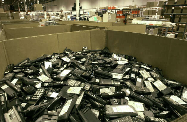 Cellphones and other communications devices can be recycled at a number of places around San Antonio. Photo: Associated Press File Photo / AP