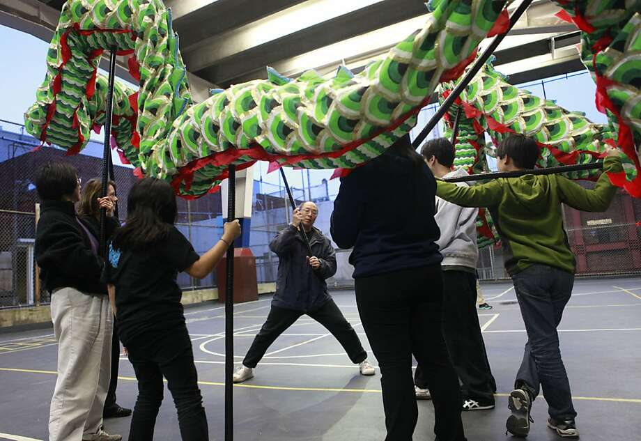Corey Chan, who has been teaching Dragon Dancing since 1998, leads a community class at a basketball court in San Francisco, Calif. on Wednesday, April 4, 2012. Photo: Jill Schneider, The Chronicle