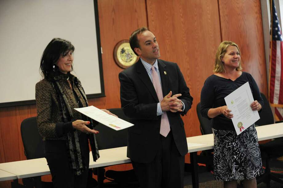 Brita Darany Von Regensburg, founder and president of Friends of Autistic People, left, and Teresa Ginsberg, right, special education chairman for PTA council received two proclamations from Greenwich First selectman Peter Tesei.  Friends of Autistic People and Special Education Supports observes Greenwich Autism Awareness Month, at Greenwich Town Hall Wednesday, April 18, 2012 . Photo: Helen Neafsey / Greenwich Time