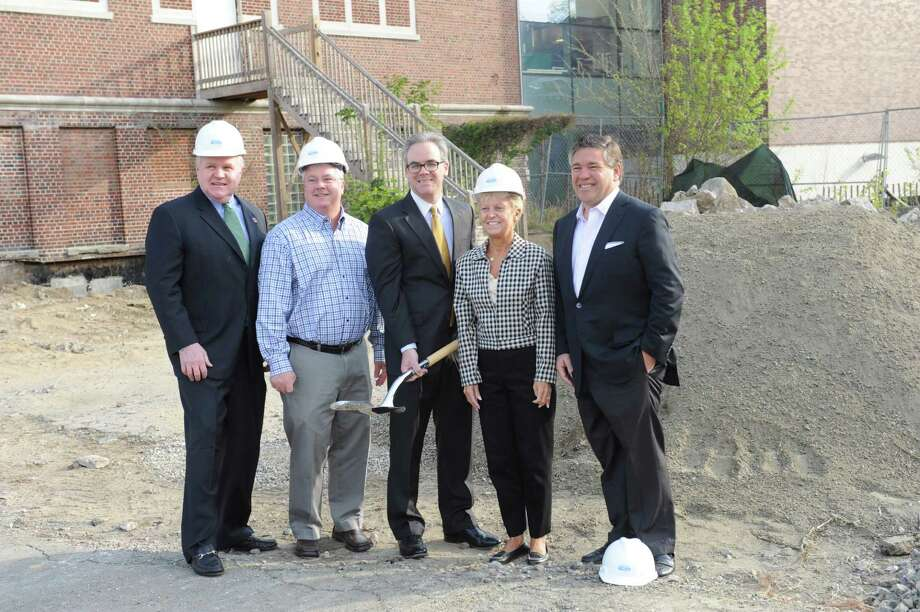 From left: Charlie Leigh, YMCA of Greenwich chief executive officer; John Howland, of First Bank of Greenwich; Dale Lucian, YMCA chief operating officer; and Jim Cabrera, YMCA chairman of the board, during a groundbreaking ceremony Wednesday, April 18, 2012, to celebrate the resumption on the YMCA's renovation project. This will enable the facility to provide elevator access to all levels, complete work on new locker rooms, rest rooms and great hall, and reopen an indoor track, according to Y officials. The renovations will also give the YMCA flexibility to expand its day care facility. Photo: Helen Neafsey / Greenwich Time