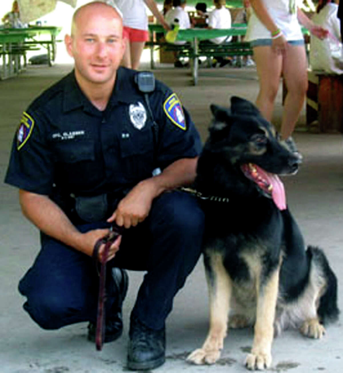 SPECTRUM/Brian Glasser, now a sergeant with the New Milford Police Department, is shown here in his favorite photo with police dog Onyx. Courtesy of the New Milford Police Department