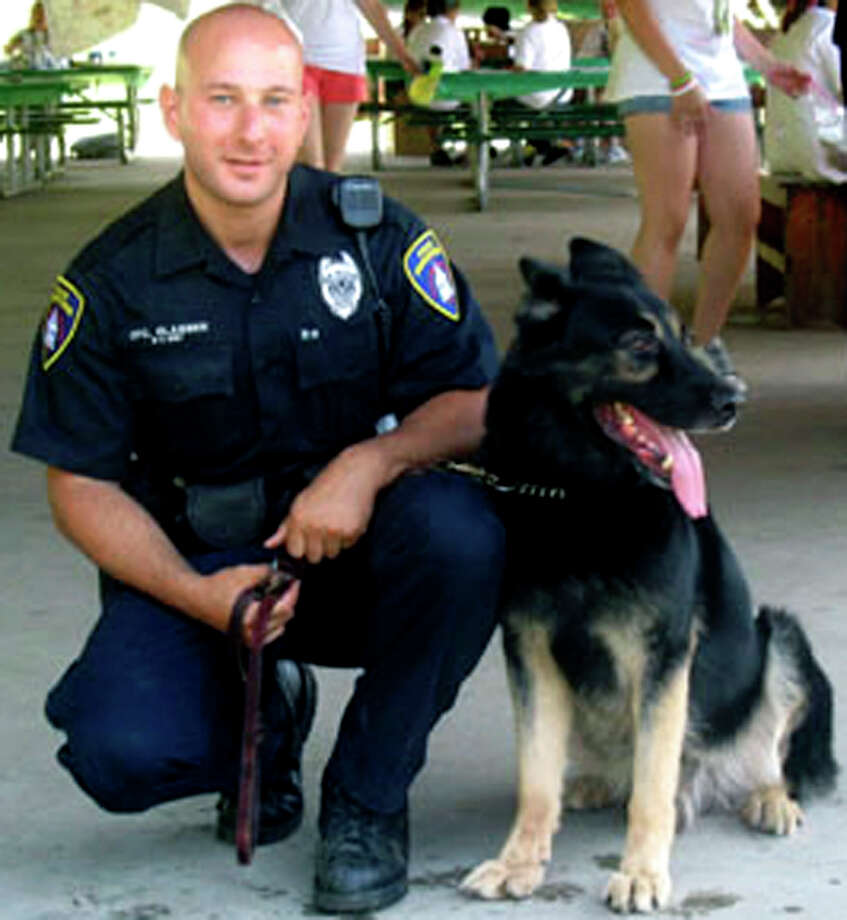 SPECTRUM/Brian Glasser, now a sergeant with the New Milford Police Department, is shown here in his favorite photo with police dog Onyx.  Courtesy of the New Milford Police Department Photo: Contributed Photo