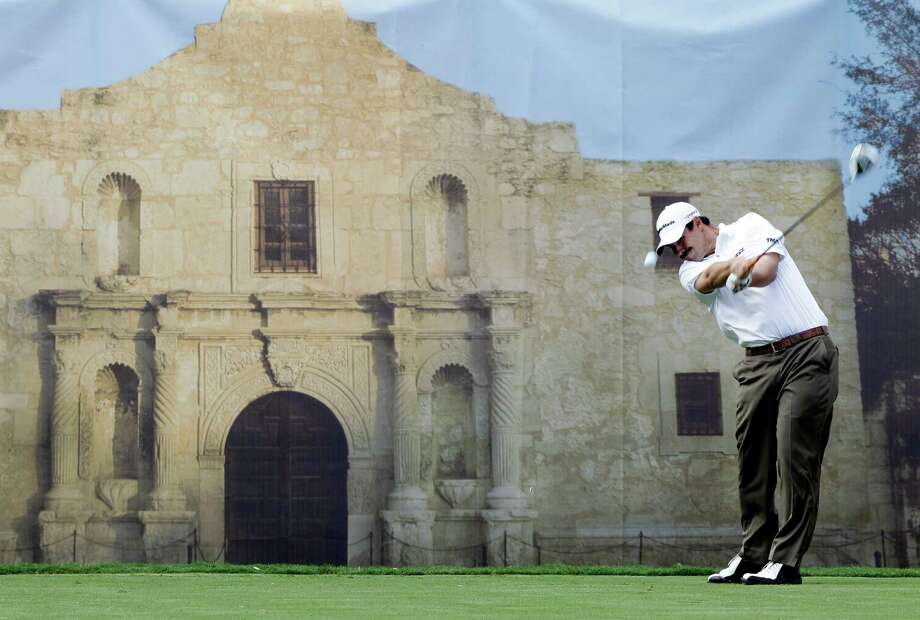 Johnson Wagner hits from the 18th tee  during the pro-am at the Texas Open golf tournament, Wednesday, April 18, 2012, in San Antonio. A mural of the Alamo is in the background. Photo: AP