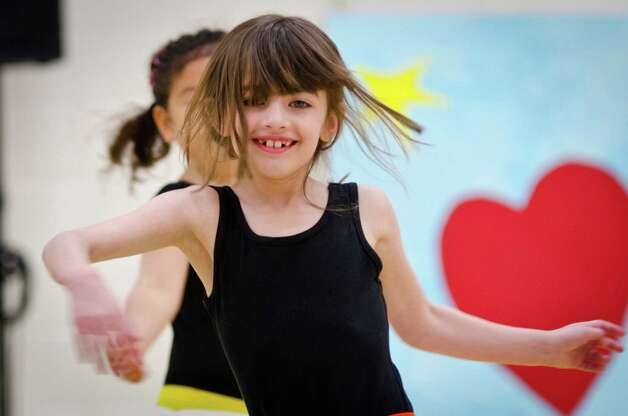 "Emily Goodman shows off her moves at Greenwich Academy's recent ""Dance Around."" Photo: Wayne Lin, Wayne K Lin, Greenwich Academy / (c) 2011 Greenwich Academy"