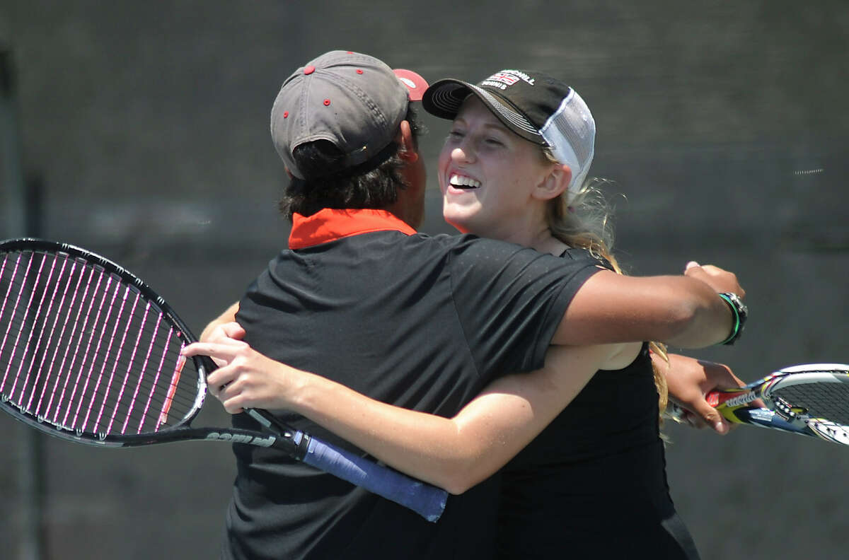 Brien Galon and Taryn Strahl of Churchill High School embrace after defeating Harlingen in the Region IV-5A tennis tournament at the McFarlin Tennis Center on Wednesday, April 18, 2012. Billy Calzada / San Antonio Express-News