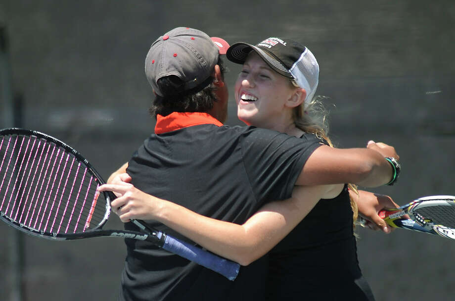 Brien Galon and Taryn Strahl of Churchill High School embrace after defeating Harlingen in the Region IV-5A tennis tournament at the McFarlin Tennis Center on Wednesday, April 18, 2012. Billy Calzada / San Antonio Express-News Photo: BILLY CALZADA, Express-News / San Antonio Express-News
