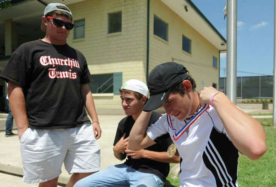 Region IV-5A tennis tournament boys singles winner Tito Moreiras dons his gold medal as Bradley Hurt, standing, and Jimmy Colborn keep him company at the McFarlin Tennis Center on Wednesday, April 18, 2012. Billy Calzada / San Antonio Express-News Photo: BILLY CALZADA, Express-News / San Antonio Express-News
