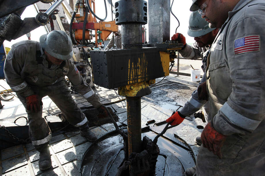 Oil-field workers drill at a site near Carrizo Springs at a well owned by Chesapeake Energy in this file photo. September's jobs report showed that the sector that includes oil and gas production had the state's highest seasonally adjusted growth rate of 9.6 percent. Photo: Jerry Lara, San Antonio Express-News / © San Antonio Express-News