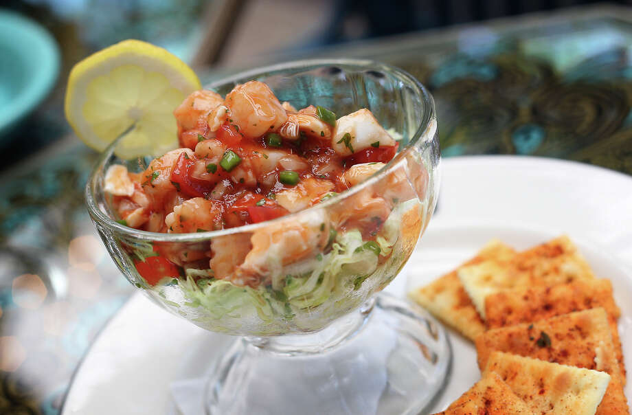 The shrimp and crab campachena from Ocho at Hotel Havana on Wednesday, Apr. 18, 2012. The shrimp and crab are poached and tossed in a spicy tomato and lime sauce. Kin Man Hui/Express-News. Photo: Kin Man Hui, San Antonio Express-News / ©2012 San Antonio Express-News
