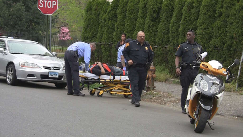 A biker was injured when he swerved to avoid one car and then struck another car on Dewey Street in Bridgeport on Wednesday, April 18, 2012. Photo contributed by Steve Krauchick of DoingItLocal.com. Photo: Steve Krauchick