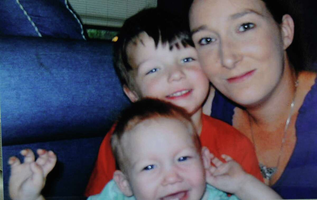 Kala Golden Schuchardt, killed Tuesday and her 3-day-old baby abducted and later recovered, is shown with two sons.