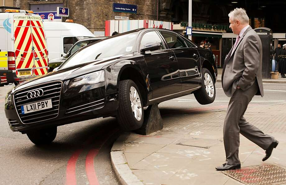 Parallel parking fail:An Audi suffers an owie near London Bridge station in London. Photo: Leon Neal, AFP/Getty Images