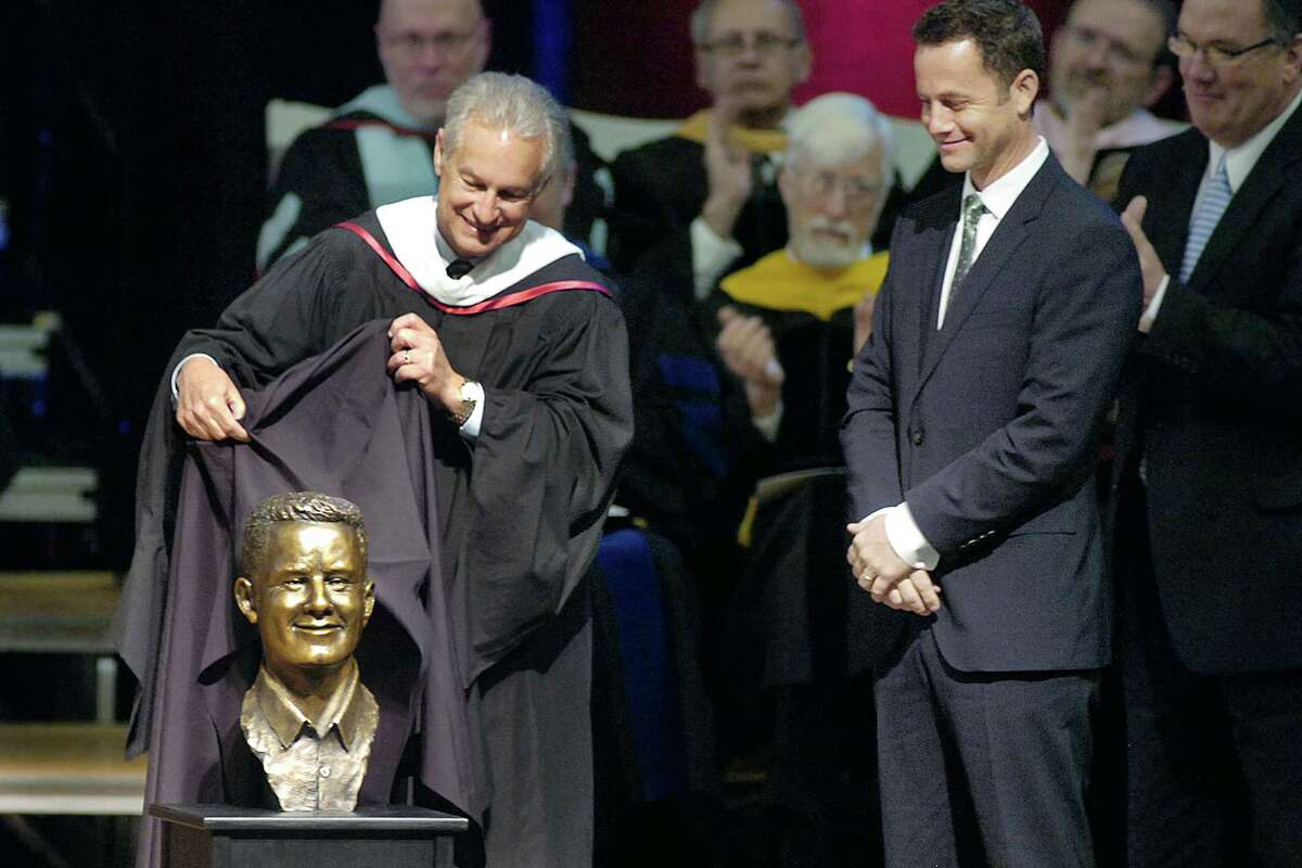 Indiana Wesleyan University Board of Trustees Chair Carl Shepherd unveils a bronze bust of actor and Christian evangelist Kirk Cameron as Cameron, at right, watches during the Society of World Changers ceremony Wednesday, April 11, 2012, in the IWU Chapel Auditorium in Marion, Ind. Cameron was inducted into the society for his humanitarian work and his strong commitment to Christian principles.