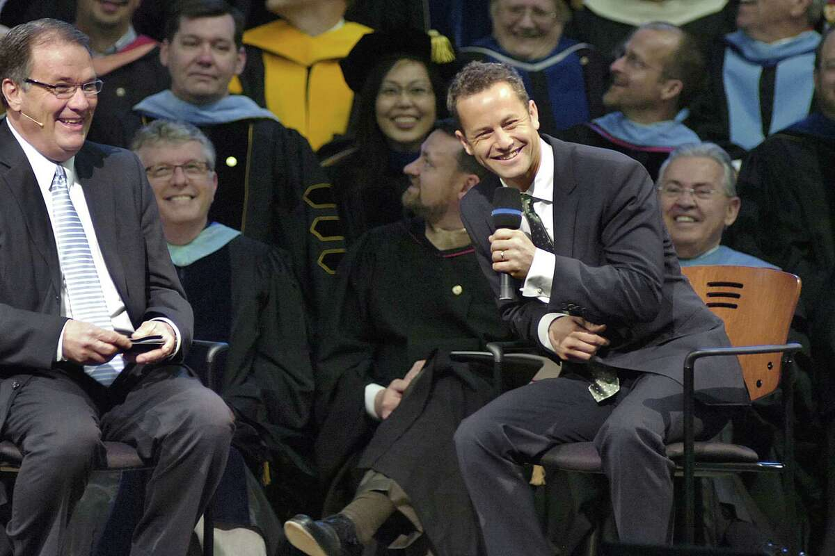Now: Actor and Christian evangelist Kirk Cameron (at right) jokes with the audience as he talks about his life, his work and his conversion to Christianity during the Society of World Changers ceremony on April 11, 2012, at Indiana Wesleyan University's Chapel Auditorium in Marion, Ind.