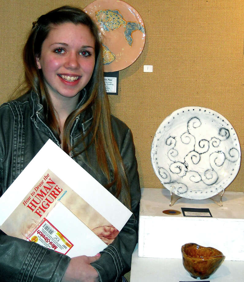 SPECTRUM/Twenty art students from New Milford High School recently participated in the Kent Art Association student show. Two were awarded prizes: senior Kayla Marlowe, above, who won an award for a wax resist plate,  and freshman Taryssa Killian for a pastel.  Courtesy of New Milford High School Photo: Contributed Photo