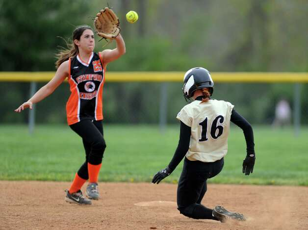 Stamford's Courtney Kuzco catches the ball as Trumbull's Jill Noto slides to second during their softball game Wednesday, April 18, 2012 at Trumbull High School. Photo: Autumn Driscoll / Connecticut Post