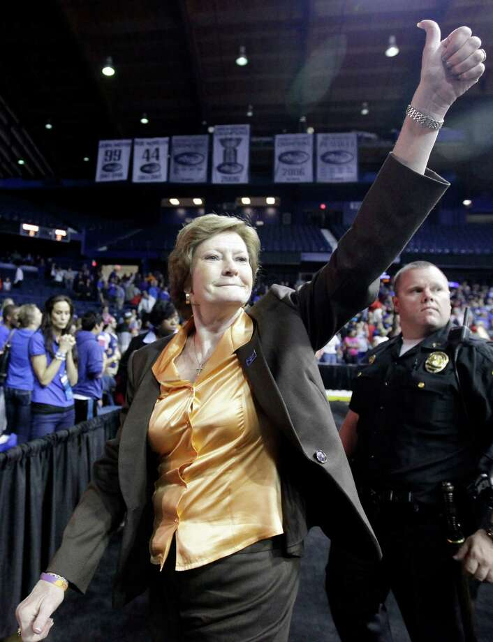 "FILE - In this March 19, 2012, file photo, Tennessee head coach Pat Summitt gives a thumbs-up as she leaves the court after Tennessee defeated DePaul 63-48 in an NCAA tournament second-round women's college basketball game in Rosemont, Ill. Summitt, the sport's winningest coach, is stepping aside as Tennessee's women's basketball coach and taking the title of ""head coach emeritus"", the university announced Wednesday, April 18, 2012. Long-time assistant Holly Warlick has been named as Summitt's successor.(AP Photo/Nam Y. Huh, File) Photo: Nam Y. Huh, Associated Press / AP2012"