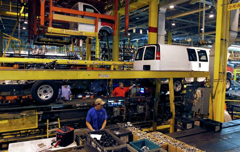 FILE - In this Nov. 3, 2011, file photo, General Motors employees work on a van assembly line at GM's plant in Wentzville, Mo. The U.S. auto industry, already stretched to meet growing car and truck sales, faces parts shortages that could limit the number of new vehicles in showrooms later this year and crimp a historic turnaround. The most immediate problem, the shortage of a crucial plastic resin, could surface in few weeks. And later in the year, automakers could face an even bigger crisis, running short of parts simply because there aren?t enough factories and people left to make them.  (AP Photo/Jeff Roberson, File) Photo: Jeff Roberson / AP2011