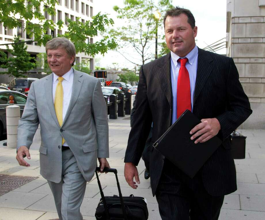Former Major League Baseball pitcher Roger Clemens and his lawyer Rusty Hardin, left, leave Federal Court in Washington, as the second day of jury selection in his perjury trial wraps uo, Tuesday, April 17, 2012. (AP Photo/Manuel Balce Ceneta) Photo: Manuel Balce Ceneta / AP