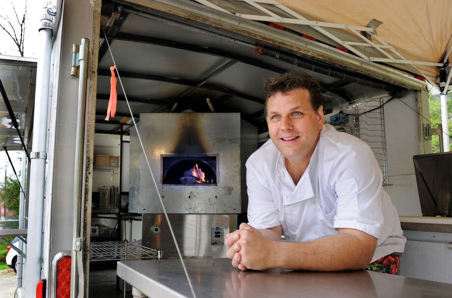Bruce Lyon of Danbury has opened a new mobile pizza and catering company called Victoria's Wood Fired Pizza. Photo: Carol Kaliff / The News-Times