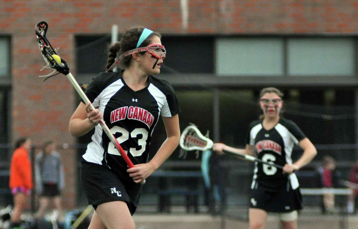 New Canaan's Kristine Ryan (23) controls the ball during the girls lacrosse game against Darien at Darien High School on Wednesday, Apr. 18, 2012.