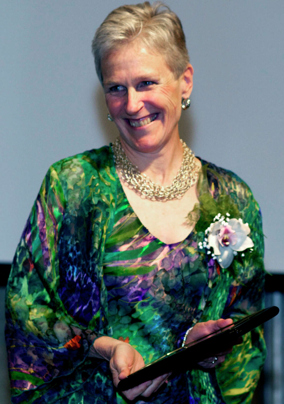 SPECTRUM/Peg Molina, the New Milford Social Services director, beams April 11 as she accepts the inaugural award for