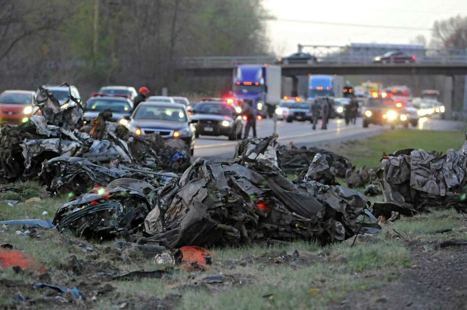 A tractor-trailer headed northbound on I-87 just above the twin bridges rolled over and spilled this massive amount of scrap metal near Clifton Park Wednesday night. The accident caused major traffic delays in both the north and south directions. (Lori Van Buren / Times Union) Photo: Lori Van Buren