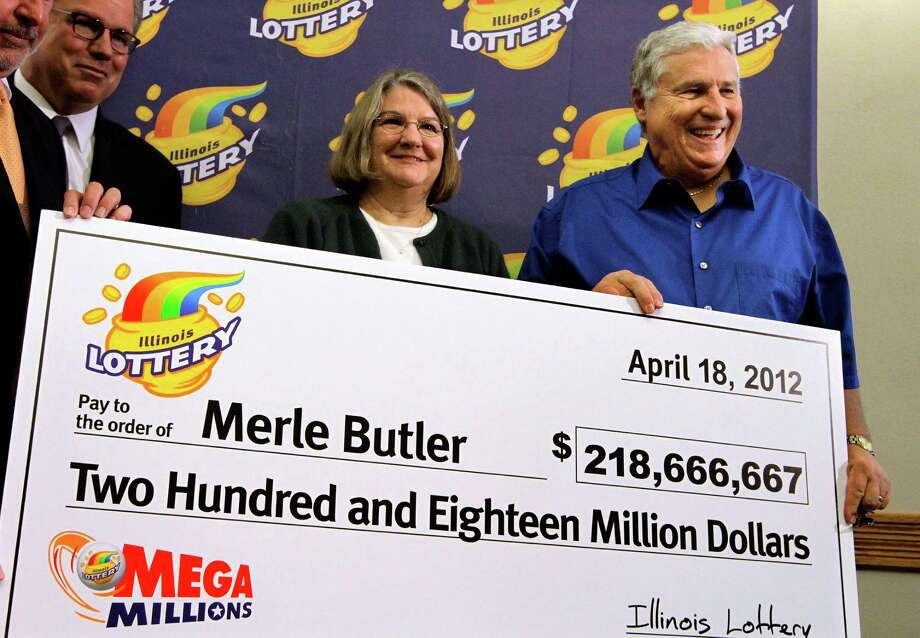Merle and Patricia Butler, of Red Bud, Ill., pose with a novelty check during a news conference at the Red Bud Village Hall on Wednesday, April 18, 2012 in Red Bud, Ill. The retired southern Illinois couple has claimed the third and final share of last month's record $656 million Mega Millions jackpot. (AP Photo/Seth Perlman) Photo: Seth Perlman / AP