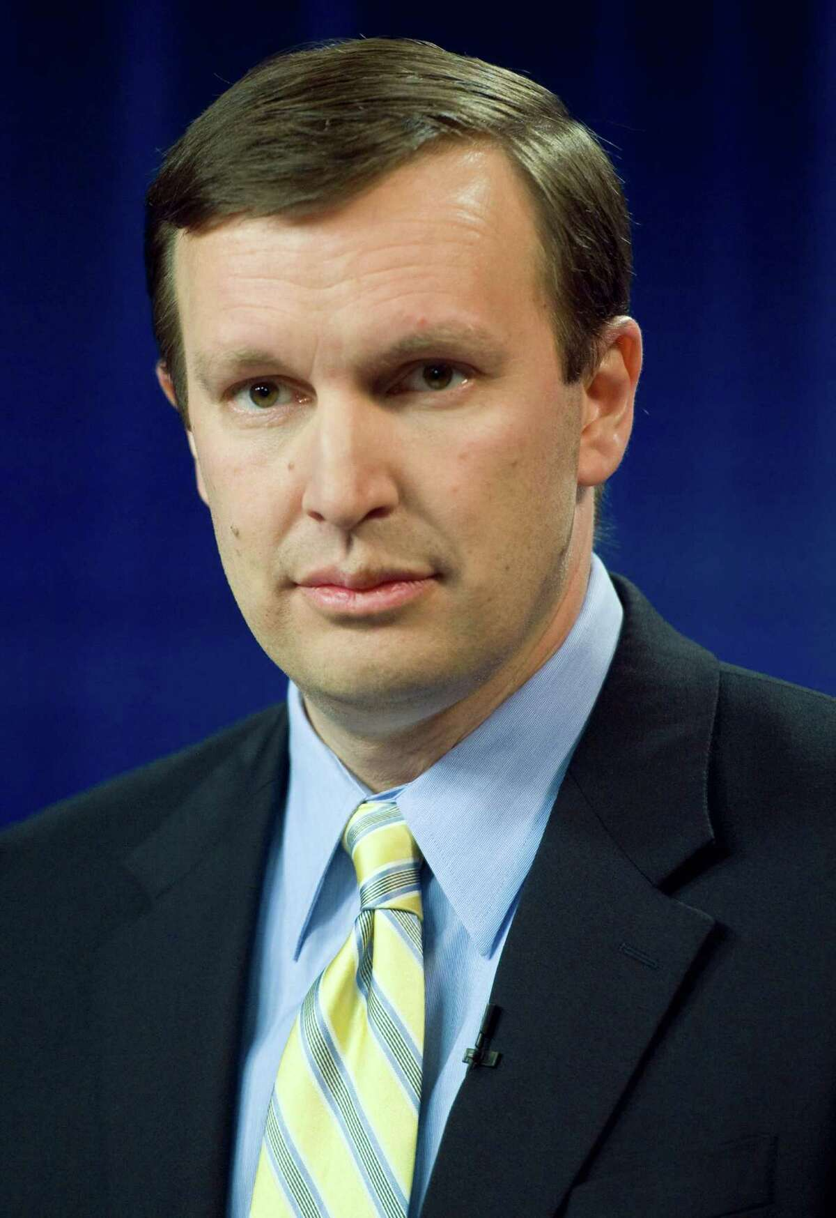 Democratic candidate for U.S. Senate, U.S. Rep. Chris Murphy, D-Conn., stands at a podium before a live televised debate in West Hartford, Conn., Thursday, April 5, 2012. (AP Photo/Jessica Hill)