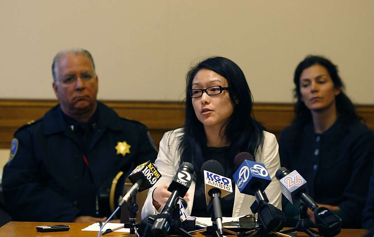 Jane Kim, center, presents the Board of Supervisors plans on San Francisco's New Street Safety Program at a meeting between partners of the program and the media at City Hall in San Francisco, Calif on April 10, 2012.