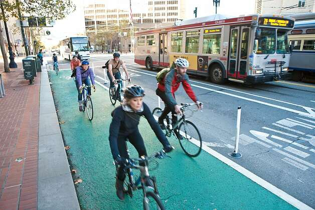 Bicyclists ride on a protected roadway on Market Street. Photo: S.F. Bicycle Coalition