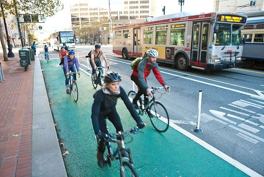 Bicyclists ride on a protected roadway on Market Street. San Francisco has added 20 miles of bike lanes in the past two years. Photo: S.F. Bicycle Coalition