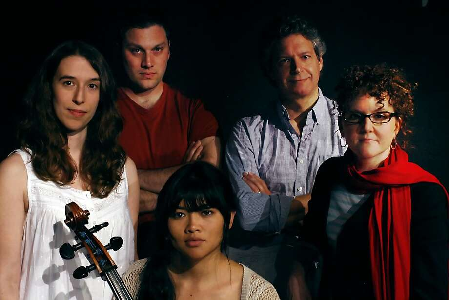 "Actors Maria Giere marquis, left, Cooper Carlson and El Beh, foreground left, pose for a picture with play writer Anthony Clarvoe, center back, and director Jill MacLean, right, at Boxcar Theatre for the play ""Cello"" opening on April 22, 2012 in San Francisco, Calif. Photo: Siana Hristova, The Chronicle"