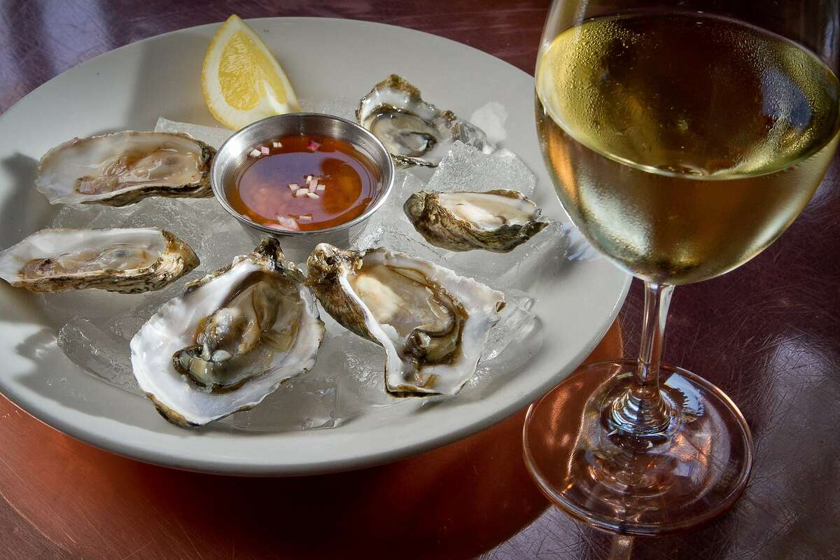A plate of Oysters and a glass of white wine at the Zuni Cafe in San Francisco, Calif., is seen on Wednesday April 15th, 2012.