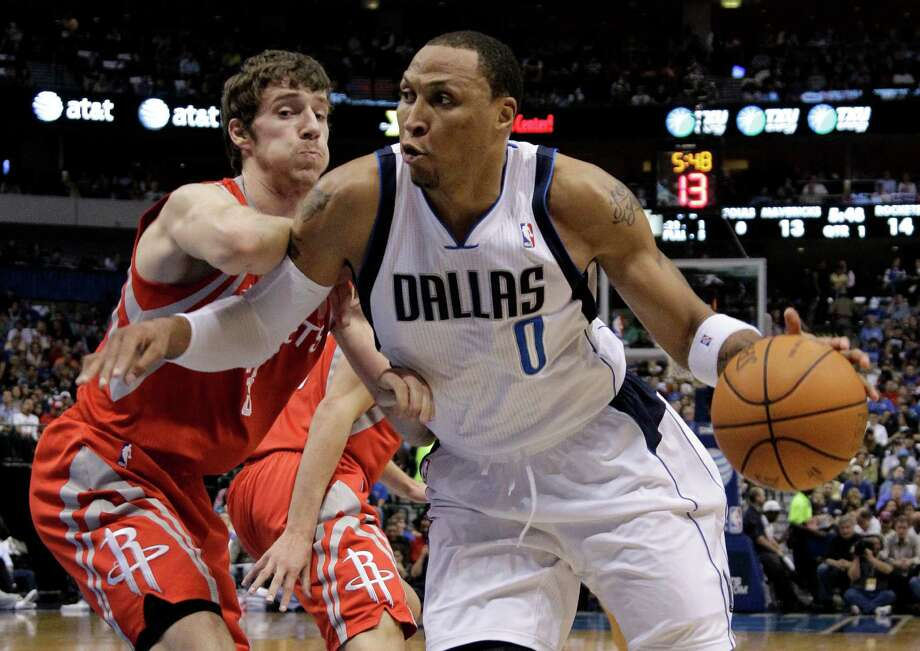 Dallas Mavericks' Shawn Marion (0) positions against Houston Rockets' Goran Dragic, left, of Slovenia, in the first half of an NBA basketball game on Wednesday, April 18, 2012, in Dallas. (AP Photo/Tony Gutierrez) Photo: Tony Gutierrez, Associated Press / AP