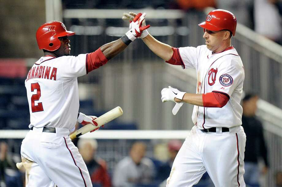 Adam LaRoche (right) is congratulated by teammate Roger Bernadina after scoring to put the Nats up 3-2 in the eighth. Photo: Greg Fiume, Getty Images / 2012 Getty Images