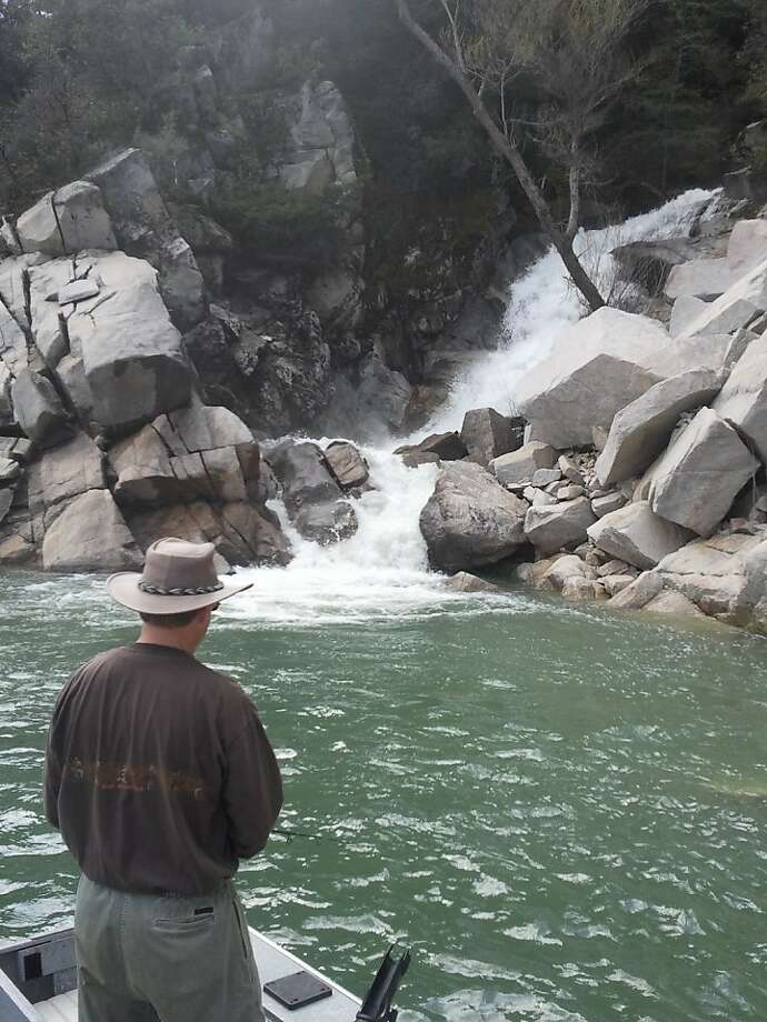 Tom Hedtke fishes one of the many little waterfalls cascading into Lake Oroville this week. We caught several bass and some anglers reported they also caught coho salmon at the same spots.  Tom Stienstra/The Chronicle Photo: Tom Stienstra, The Chronicle