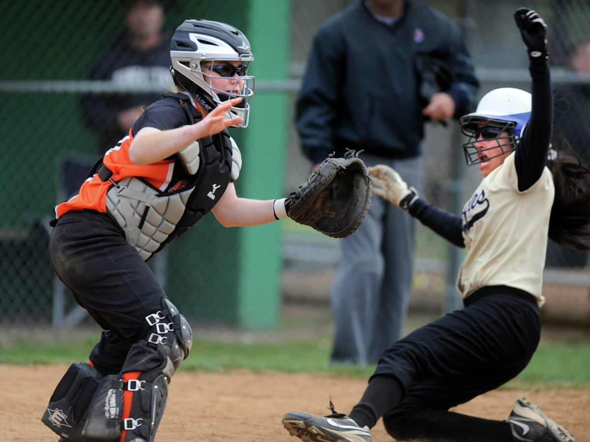 Trumbull's Veronica Alicea scores the winning run in the 8th inning as Stamford catcher Colleen Adams waits for the ball during their softball game Wednesday, April 18, 2012 at Trumbull High School.
