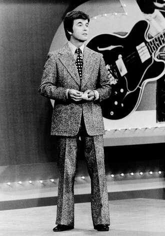 "In this 1973 file photo released by ABC, Dick Clark presents the Rock and Roll Year_ a musical portrait of the 1950s and 1960s on the ABC television network in a series of five specials. Clark, the television host who helped bring rock `n' roll into the mainstream on ""American Bandstand,"" died Wednesday, April 18, 2012 of a heart attack. He was 82. Photo: AP"