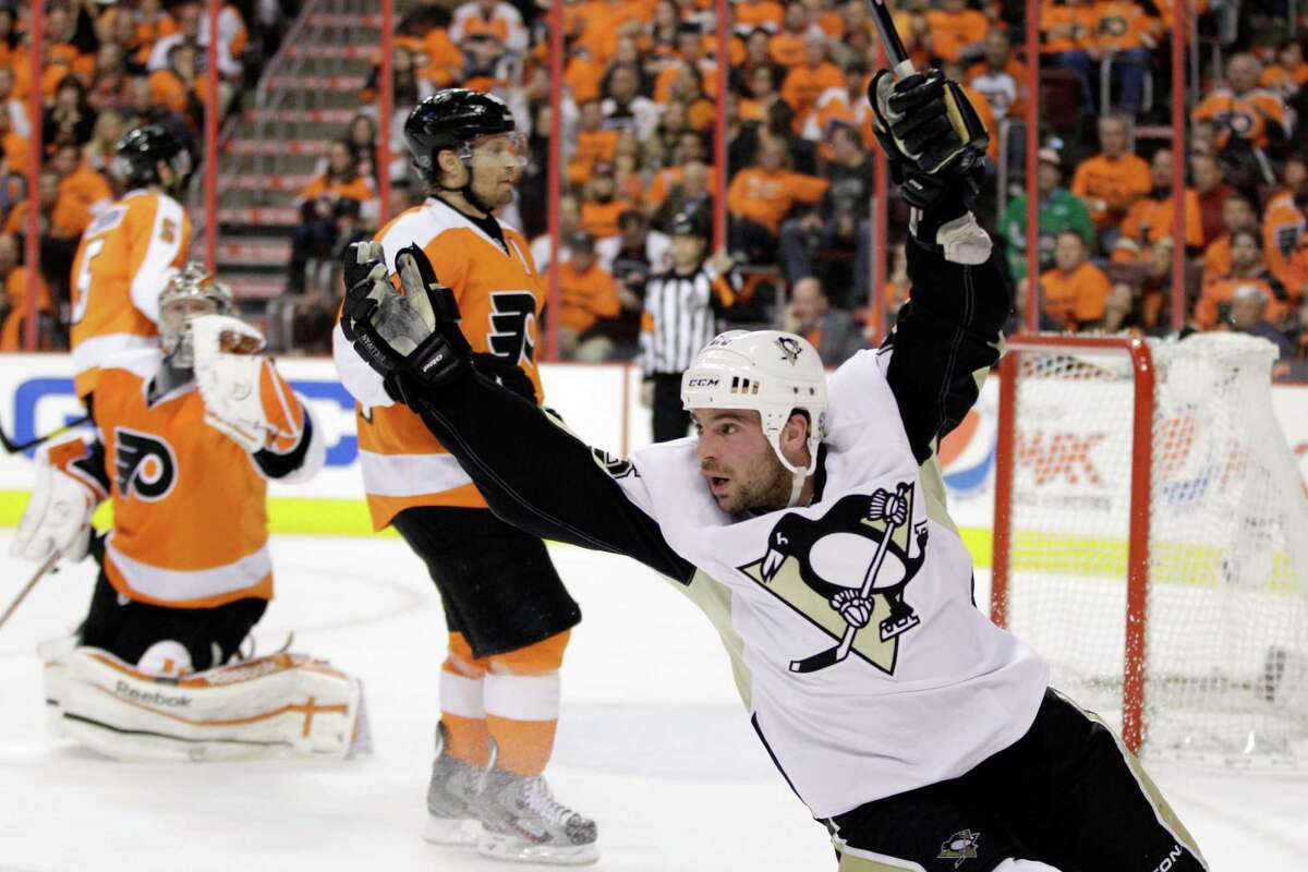 Pittsburgh Penguins' Steve Sullivan, right, celebrates after scoring a goal against Philadelphia Flyers' Kimmo Timonen, center, of Finland, and Sergei Bobrovsky, of Russia, in the second period of Game 4 in a first-round NHL Stanley Cup playoffs hockey series on Wednesday, April 18, 2012, in Philadelphia.