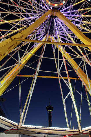 The 100-foot Giant Wheel sports LED lighting at the Fiesta Carnival by the Alamodome. This year, the carnival is getting greener with LED lights. Photo: JERRY LARA, San Antonio Express-News / © 2012 San Antonio Express-News