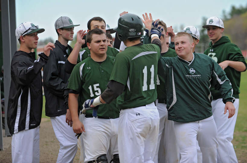 Shenendehowa's Chris Miller, #11, gets a nice welcome back to the dugout after hitting a home run du