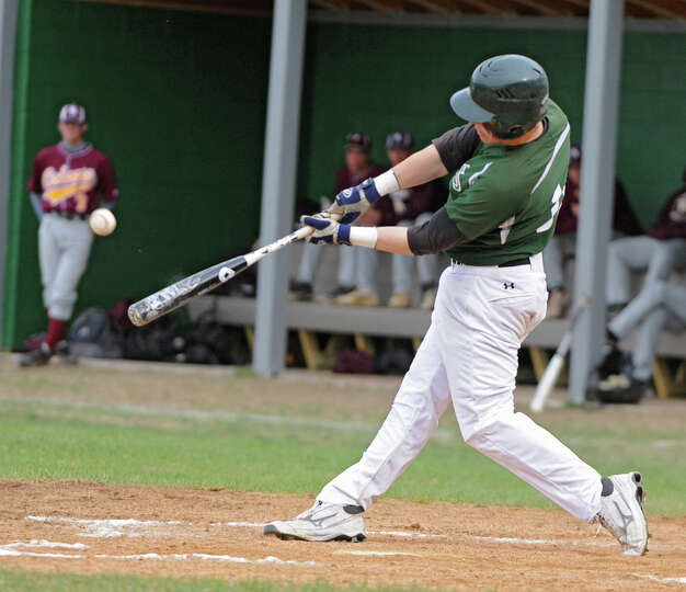 Shenendehowa's Chris Miller hits the ball for a home run during a baseball game against Colonie on A