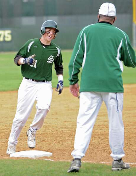 Shenendehowa's Chris Miller rounds third base with a smile after hitting a home run during a basebal