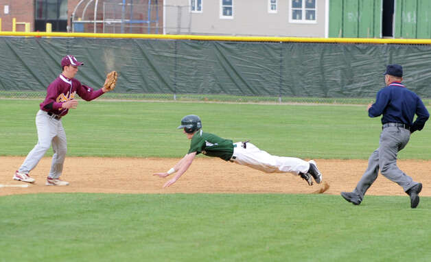 Shenendehowa's Colin Grande's early dive to second base got him there safe before Colonie's shortstop Jeff Bink can tag him during a baseball game on April 18, 2012 in Clifton Park, N.Y. (Lori Van Buren / Times Union) Photo: Lori Van Buren