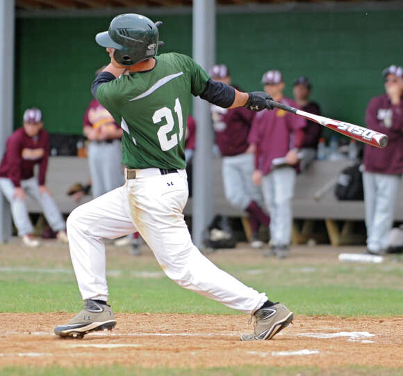 Shenendehowa's shortstop Justin Yurchek hits the ball during a baseball game against Colonie on Apri