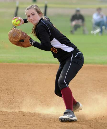 Colonie shortstop Stephanie Reinhardt throws the ball to first base during a softball game against S