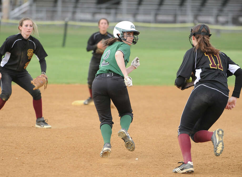 Shenendehowa's Taylor Fitzgerald finally gets tagged out by Colonie's Mary Elizabeth Waterman, #11, in a pickle between second and third base during a softball game on April 18, 2012 in Clifton Park, N.Y. (Lori Van Buren / Times Union) Photo: Lori Van Buren