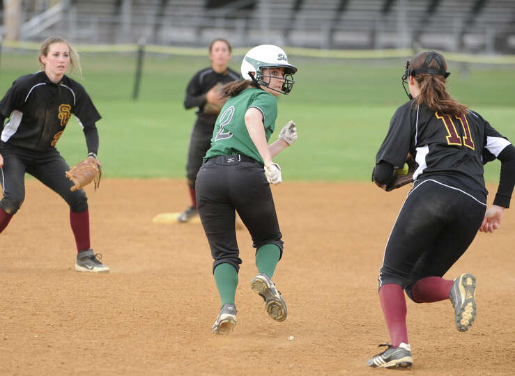 Shenendehowa's Taylor Fitzgerald finally gets tagged out by Colonie's Mary Elizabeth Waterman, #11,