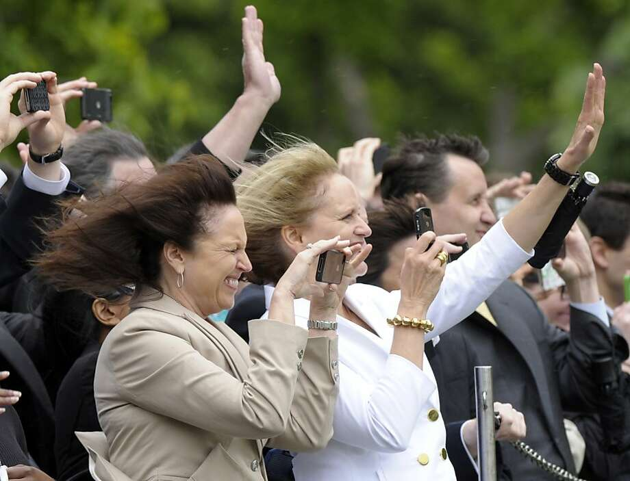 People watch and wave as President Barack Obama leaves via Marine One from the South Lawn of the White House in Washington, Wednesday, April 18, 2012. Obama is heading to Ohio and Michigan. (AP Photo/Susan Walsh) Photo: Susan Walsh, Associated Press